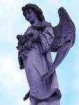 Statue_at_Metairie_Cemetery.jpg
