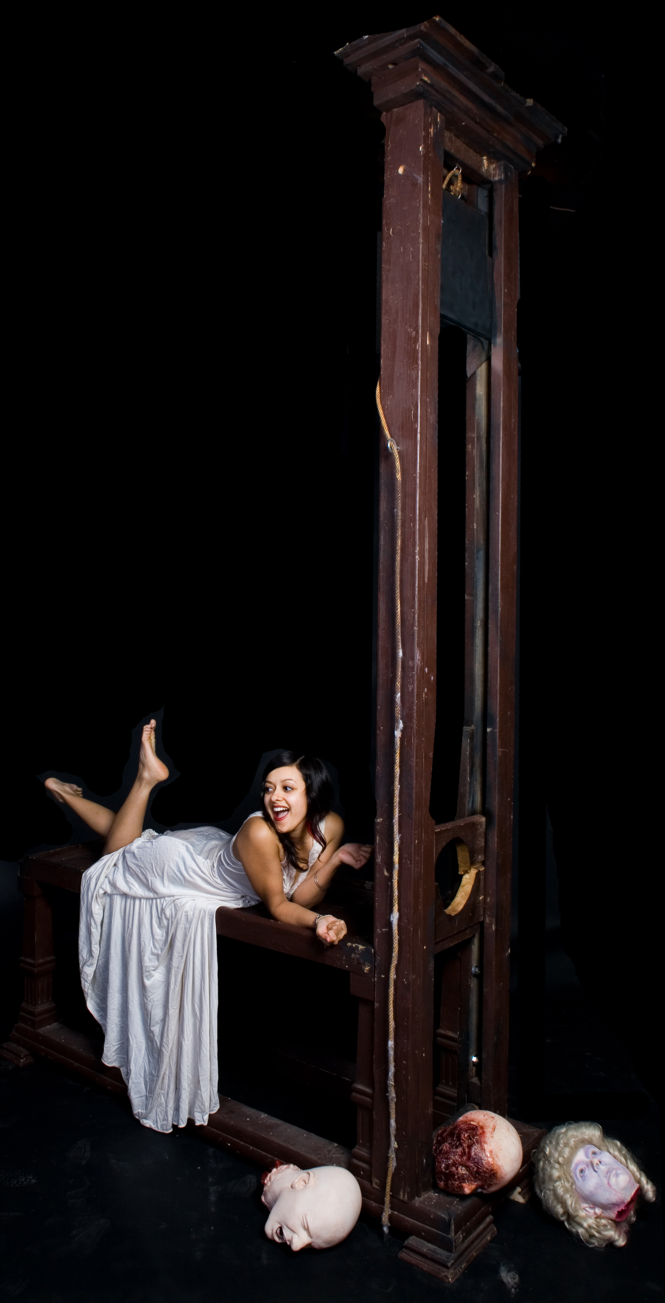 Girl On Guillotine http://www.bjwinslow.com/gallery/dapper-cadaver-girls-radhika/12_ft_guillotine_33