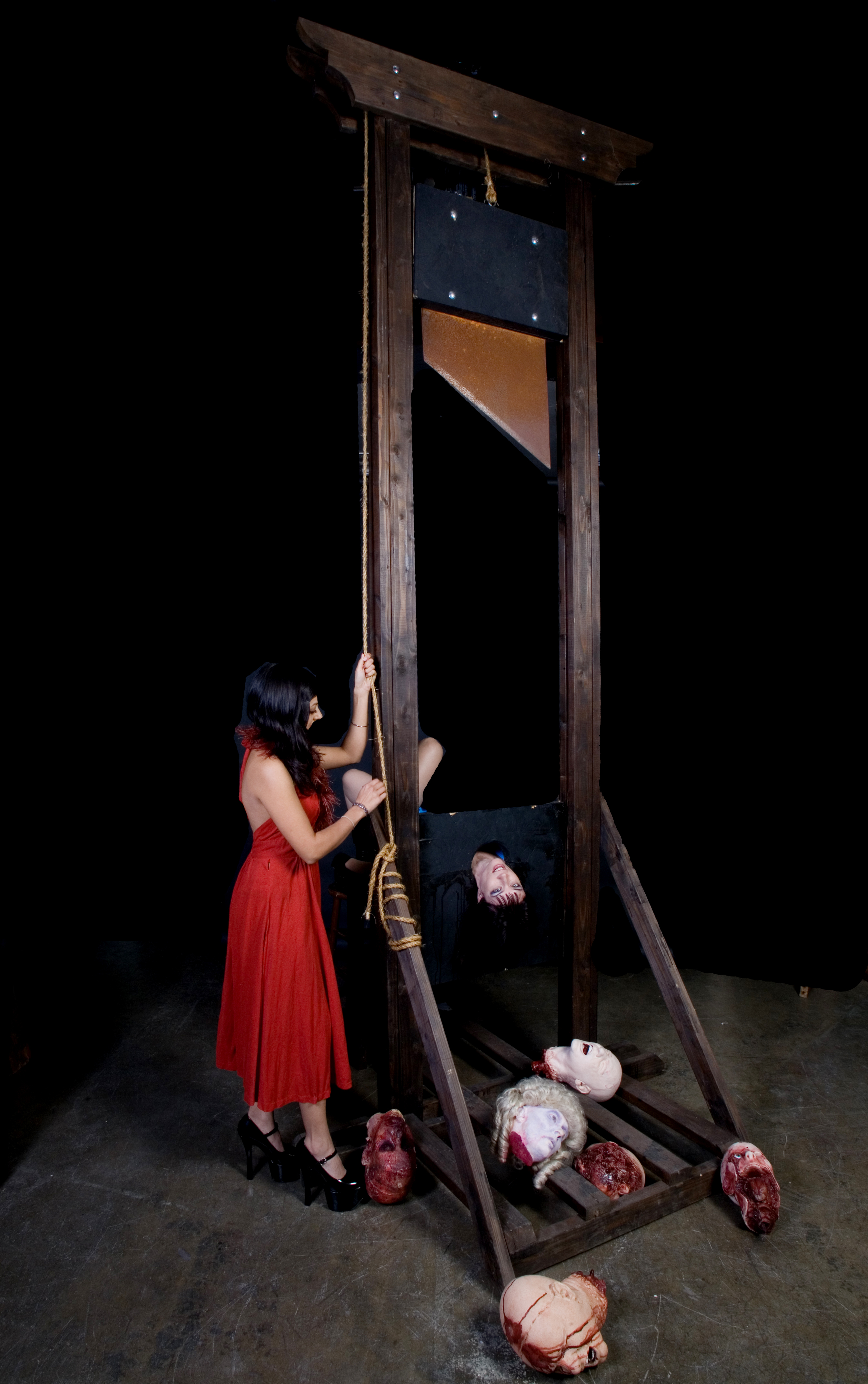 Girl On Guillotine http://www.bjwinslow.com/gallery/dapper-cadaver-girls-radhika/14_ft_guillotine_81