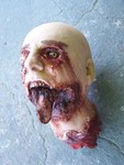 mutilated head with tongue 75