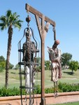 gallows tree with gibbets and skeletons.jpg